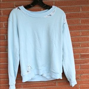 Distressed style sweatshirt with lace detailing.
